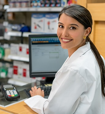 Pharmacist serving customers with high-speed satellite Internet backup